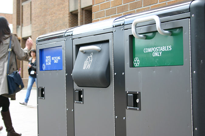 waste bins that say recycle garbage and compost only