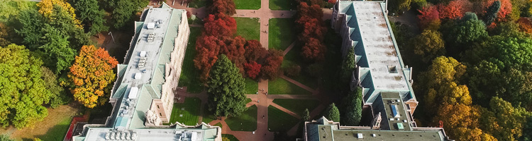 aerial view of the south end of the quad with buildings pathways trees and grass in view