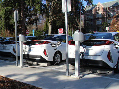 electric cars charging in a UW parking lot